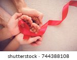 adult and child hands holding... | Shutterstock . vector #744388108