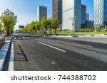city road through modern... | Shutterstock . vector #744388702