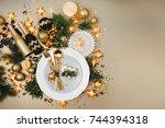 christmas table setting. gold... | Shutterstock . vector #744394318
