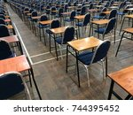 An Empty Exam Hall With Chair...