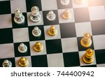 The King in battle chess game stand on chessboard with black isolated background. Business leader concept for market target strategy. Intelligence challenge and business competition success play.