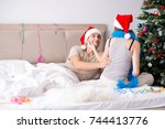 young happy family celebrating... | Shutterstock . vector #744413776