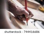 carpenter woodwork job.... | Shutterstock . vector #744416686