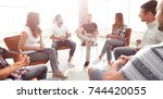 business team talking in the... | Shutterstock . vector #744420055