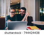 cheerful good looking employees ... | Shutterstock . vector #744424438