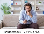 student gamer playing games at... | Shutterstock . vector #744435766