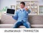 man freelancer in a cervical... | Shutterstock . vector #744442726