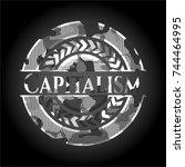 capitalism on grey camo texture | Shutterstock .eps vector #744464995