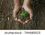 hands was carrying a bag of... | Shutterstock . vector #744480025