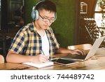 school children doing homework... | Shutterstock . vector #744489742