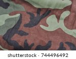Small photo of Military army camouflage fabric texture pattern background for design. Military army camouflage background. Military army camouflage pattern cloth. Military army camouflage texture.