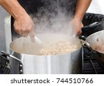 close up on male hands mixing... | Shutterstock . vector #744510766