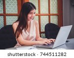 young woman happy with online... | Shutterstock . vector #744511282