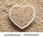brown rice in heart shaped bowl ... | Shutterstock . vector #744532465