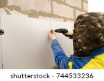 the worker insulates the house... | Shutterstock . vector #744533236