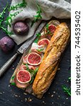 sandwich with figs and... | Shutterstock . vector #744535402