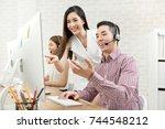 female asian supervisor... | Shutterstock . vector #744548212
