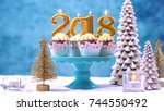 happy new year 2018 cupcakes on ... | Shutterstock . vector #744550492