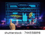 hand using abstract hud on... | Shutterstock . vector #744558898