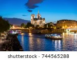notre dame de paris with cruise ... | Shutterstock . vector #744565288