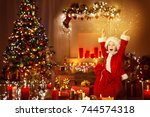 christmas child happy presents... | Shutterstock . vector #744574318