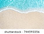 sea beach and soft wave of blue ... | Shutterstock . vector #744593356