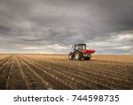 tractor spreading artificial... | Shutterstock . vector #744598735