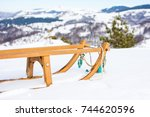 wooden sleds on snow covered... | Shutterstock . vector #744620596