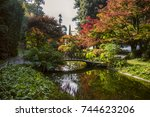 bridge in a magnificent garden... | Shutterstock . vector #744623206