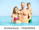 happy family resting at sea... | Shutterstock . vector #744640366