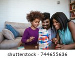 a happy black family palying a... | Shutterstock . vector #744655636