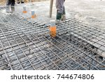 pouring concrete slab  ... | Shutterstock . vector #744674806