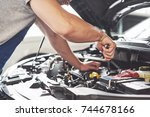 auto mechanic working in garage....   Shutterstock . vector #744678166