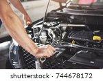 close up hands of... | Shutterstock . vector #744678172