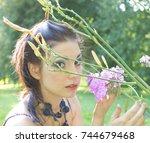 vivid makeup caucasian girl    Shutterstock . vector #744679468