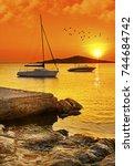boats resting near the coast in ... | Shutterstock . vector #744684742