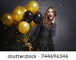 woman giving a cheer for new... | Shutterstock . vector #744696346