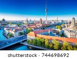 Stock photo panoramic view at the berlin city center at sunset 744698692