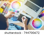 graphic designer drawing on... | Shutterstock . vector #744700672