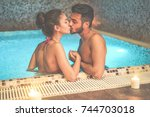 couple of lovers kissing in spa ... | Shutterstock . vector #744703018