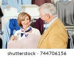 elderly couple choosing clothes ...   Shutterstock . vector #744706156