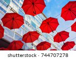Red Umbrellas As Street...