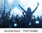 hand with a smartphone records... | Shutterstock . vector #744716086