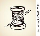 wooden sheave of cotton fiber... | Shutterstock .eps vector #744716536