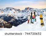 three snowboards and ski... | Shutterstock . vector #744720652