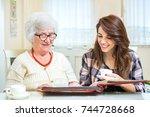 grandmother and granddaughter... | Shutterstock . vector #744728668