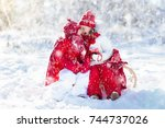 kids sledding in winter forest. ... | Shutterstock . vector #744737026