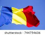 romanian flag on the mast.... | Shutterstock . vector #744754636