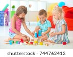 cute children playing with... | Shutterstock . vector #744762412