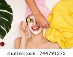spa salon  puts on face mask ... | Shutterstock . vector #744791272